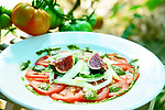tomato carpaccio with figs served in a ecological vegetable garden
