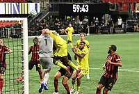 ATLANTA, GA - AUGUST 22: Brad Guzan #1 and Dominique Badji #9 contest for a crossed ball during a game between Nashville SC and Atlanta United FC at Mercedes-Benz Stadium on August 22, 2020 in Atlanta, Georgia.