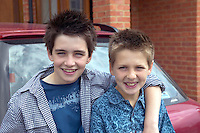 Two brothers pose outside their home in essex. England. MR