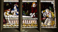 UK, England, Cambridge.  Corpus Christi Chapel, Detail from the 19th-century English Stained Glass Showing the Washing of the Body of Jesus.