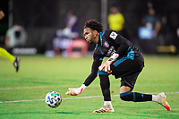 LAKE BUENA VISTA, FL - JULY 14: Pedro Gallese #1 of Orlando City SC passes the ball during a game between Orlando City SC and New York City FC at Wide World of Sports on July 14, 2020 in Lake Buena Vista, Florida.