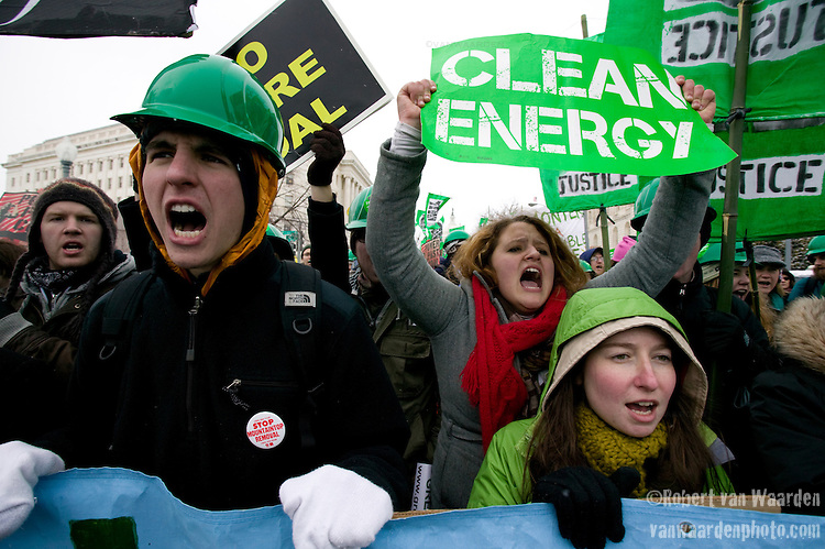 Capitol Climate Action.March 2, 2009  Capitol Coal Plant, Washington, D.C, USA.<br /> A symbol of the strangle-hold that fossil fuels have on our economy, protestors march in front of the Capitol Coal Plant in Washington DC. The protestors were calling for clean renewable energy. Two days before the planned protest, the US government announced that the plant would be converted to Natural Gas. Organizers cited this news as a partial, but incomplete victory - as Natural Gas is still a fossil fuel - and vowed to take on coal plants across the country.