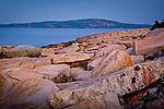 A Cadillac Mountain sunrise and Maine's rocky cliffs seen from Schoodic Peninsula, Acadia National Park, Downeast, ME, USA