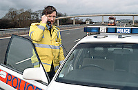 Traffic police officers with their police rapid response traffic vehicle on the motorway, the officers have laid out cones to close off lane 1 whilst another officer is using the mains set to contact control...© SHOUT. THIS PICTURE MUST ONLY BE USED TO ILLUSTRATE THE EMERGENCY SERVICES IN A POSITIVE MANNER. CONTACT JOHN CALLAN. Exact date unknown.john@shoutpictures.com.www.shoutpictures.com...
