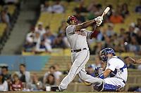 Arizona Diamondbacks outfielder Justin Upton #10 bats against the Los Angeles Dodgers at Dodger Stadium on September 13, 2011 in Los Angeles,California. Arizona defeated Los Angeles 5-4.(Larry Goren/Four Seam Images)