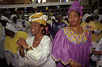 """Celestial Church of Christ South London. A daance of Thanksgiving at a Harvest festival Sundayu church service. Yoruba people from western Nigeria mainly make up this churches congreation.  from A STORM IS PASSING OVER a Look at Black Churches in Britain. Published by Thames and Hudson isbn 0 500 27826 1 This west African church was founded by S B J Oshoffa Mainly attended by Yoruba people from western Nigeria the church  flourishes with offshoots in London Paris and New York This  photograph is taken from the book The Storm is Passing Over"""""""