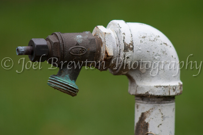 An old water spicket stands rusty and unused at Allegheny Cemetary, Pittsburgh.