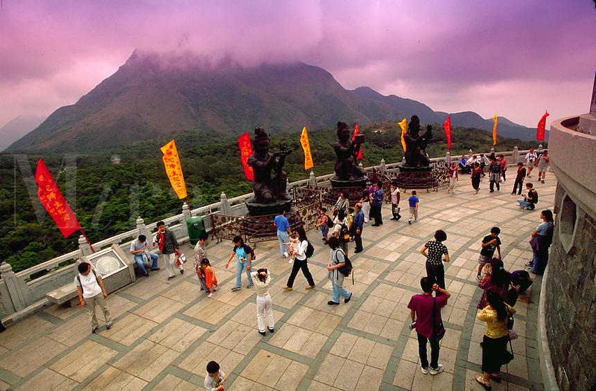 Tourists mingle with disciples at Tian Tan Buddha, Lantan, China