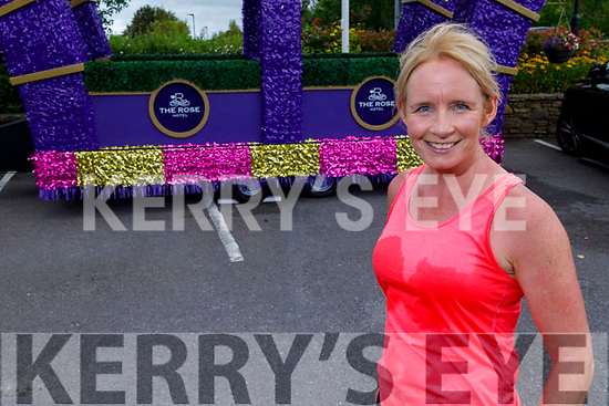 Michelle Greaney crosses the finish line of the 10 miles in 10 days challenge in memory of Conor Cusack at the Rose Hotel on Saturday.
