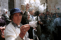 Greek Orthodox Christians take part in the traditional procession through the stations of the Via Dolorosa, traditionally believed to be Christ's route to crucifixion, in Jerusalem's Old City.