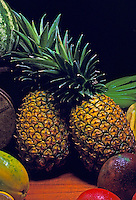 "A Hawaiian """"still life"""" with two large pineapples surrounded by other island fruits."