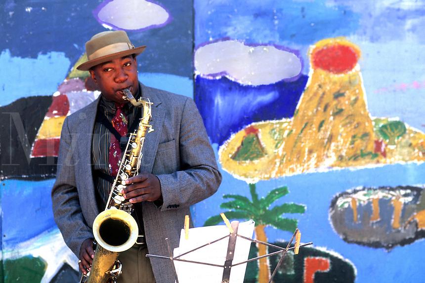 Black Afro American man playing jazz with saxophone or sax near Fisherman Wharf in San Francisco Californi