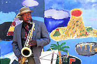 Black Afro American man playing jazz with saxophone or sax near Fisherman Wharf in San Francisco Californi