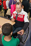 Calgary, AB - June 5 2014 - Graeme Murray visiting children during the Celebration of Excellence Heroes Tour visit to the Alberta Children's Hospital. (Photo: Matthew Murnaghan/Canadian Paralympic Committee)