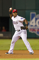 Texas Rangers third baseman Adrian Beltre #29 throws to first during the Major League Baseball game against the Baltimore Orioles on August 21st, 2012 at the Rangers Ballpark in Arlington, Texas. The Orioles defeated the Rangers 5-3. (Andrew Woolley/Four Seam Images).