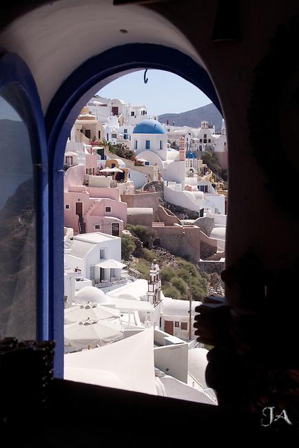 View of Oia, Santorini thru a window.