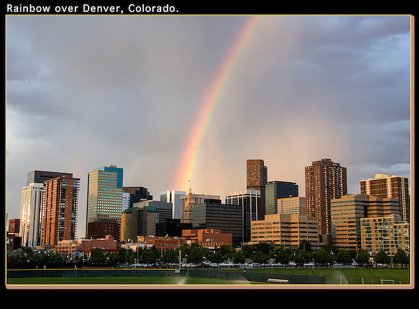 Rainbow over Denver, Colorado. .  John offers private photo tours in Denver, Boulder and throughout Colorado. Year-round Colorado photo tours.
