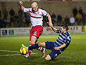 Stirling's Chris Smith clears from Forfar's Dale Hilson.