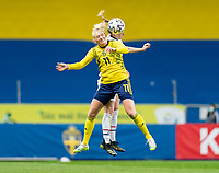 SOLNA, SWEDEN - APRIL 10: Stina Blacksenius #11 of Sweden goes up for a header with Becky Sauerbrunn #4 of the USWNT during a game between Sweden and USWNT at Friends Arena on April 10, 2021 in Solna, Sweden.