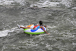 Girl in inner tube in Confluence Park, Denver, Colorado, USA.