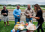 Scenes from the grandstand and the back yard on Jockey Club Gold Cup Day at Belmont Park in Elmont, New York on September 29, 2012.