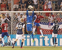 USMNT goalkeeper Sean Johnson (12) big save. In CONCACAF Gold Cup Group Stage, the U.S. Men's National Team (USMNT) (blue/white) defeated Costa Rica (red/blue), 1-0, at Rentschler Field, East Hartford, CT on July 16, 2013.