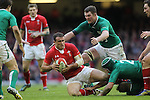 Wales centre Jamie Roberts in need of support as Jamie Heaslip, Rory Best and Peter O'Mahony combine to haul him down..RBS 6 Nations.Wales v Ireland.Millennium Stadium.02.02.13.©Steve Pope-SPORTINGWALES
