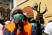 Demonstration of the agricultural laborers ' The invisibles' to ask for more rights at work. <br /> Rome (Italy), May 18th 2021<br /> Photo Samantha Zucchi Insidefoto