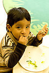Education preschoool children ages 3-5 meal time lunch closeup of boy eating vertical