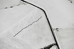Aerial views of landscape around Warrington between Barton Airport and Liverpool, in winter with snow.