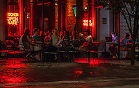 Urban Street of Memphis Tennessee, Street Photograph of a night scene in downtown Memphis.<br /> The city is located on the confluence of the Wolf and Mississippi rivers. Downtown Memphis and metro area spread out through suburbanization, and encompass southwest Tennessee, northern Mississippi and eastern Arkansas. Several large parks were founded in the city in the early 20th century