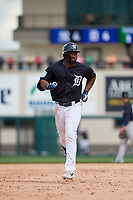 Detroit Tigers left fielder Christin Stewart (14) runs the bases during a Grapefruit League Spring Training game against the New York Yankees on February 27, 2019 at Publix Field at Joker Marchant Stadium in Lakeland, Florida.  Yankees defeated the Tigers 10-4 as the game was called after the sixth inning due to rain.  (Mike Janes/Four Seam Images)