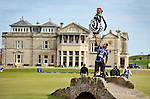 Pic Kenny Smith............. 05/10/2009.Dunhill Links Championship, St Andrews Links final day, James Kamte's caddy Hugo Benson shows off his strength and balancing skills on the Swilkan bridge as he holds aloft a full bag of clubs