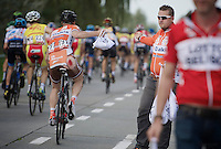Timothy Dupont (BEL/Roubaix Lille Métropole) grabs a musette in the feed zone showing some road rash from an earlier crash<br /> <br /> stage 2<br /> Euro Metropole Tour 2014 (former Franco-Belge)