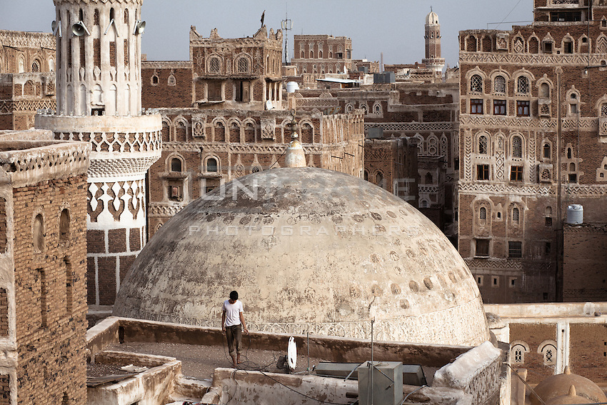 Rooftop view in Old Sana'a. Sana'a has been inhabited for more than 2,500 years, one of the oldest continuously inhabited cities in the world. In the 7th and 8th centuries the city became a major centre for the propagation of Islam. This religious and political heritage can be seen in the 103 mosques, 14 hammams and over 6,000 houses, all built before the 11th century. At an altitude of 2,300 meters (7,500 ft), it is also one of the highest capital cities in the world.