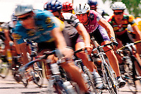 Blurred motion image of competitive cyclists in a race.