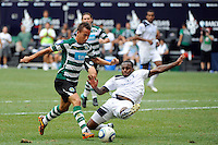 Daniel Rose (25) of Tottenham Hotspur F. C. tackles Joao Pereira (47) of Sporting Clube de Portugal. Tottenham Hotspur F. C. and Sporting Clube de Portugal played to a 2-2 tie during a Barclays New York Challenge match at Red Bull Arena in Harrison, NJ, on July 25, 2010.