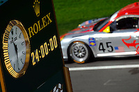 "Rolex ""Race Countdown Clock"" along pit road with the #45 Flying Lizard Porsche GT3 Cup of Jorg Bermeister, Patrick Long, Mike Rockenfeller & Seth Neiman."