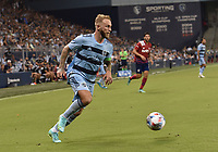 KANSAS CITY, KS - JULY 31: Johnny Russell #7 of Sporting Kansas City dribbles up the right wing during a game between FC Dallas and Sporting Kansas City at Children's Mercy Park on July 31, 2021 in Kansas City, Kansas.