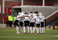 Pictured: Swansea players huddle before kick off. Saturday 07 January 2012<br /> Re: FA Cup football Barnsley FC v Swansea City FC at the Oakwell Stadium, south Yorkshire.