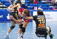 30 MAY 2012 - LONDON, GBR - Ewa Palies (GBR) of Great Britain (centre, in red and blue) finds her path to goal blocked by Sara Vukcevic (MNE) of Montenegro (right, in black and gold) during the women's 2012 European Handball Championship qualification match at the National Sports Centre in Crystal Palace, Great Britain .(PHOTO (C) 2012 NIGEL FARROW)