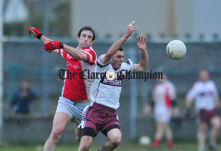 Eire Og's David Russell and Alan Clohessy of Liscannor battle for posession. Photograph by Declan Monaghan