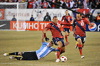Jermaine Jones (13) of the United States gets past Javier Mascherano (14) of Argentina. The United States (USA) and Argentina (ARG) played to a 1-1 tie during an international friendly at the New Meadowlands Stadium in East Rutherford, NJ, on March 26, 2011.