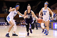 DURHAM, NC - NOVEMBER 17: Lindsey Pulliam #10 of Northwestern University drives between Leaonna Odom #5 and Haley Gorecki #2 of Duke University during a game between Northwestern University and Duke University at Cameron Indoor Stadium on November 17, 2019 in Durham, North Carolina.