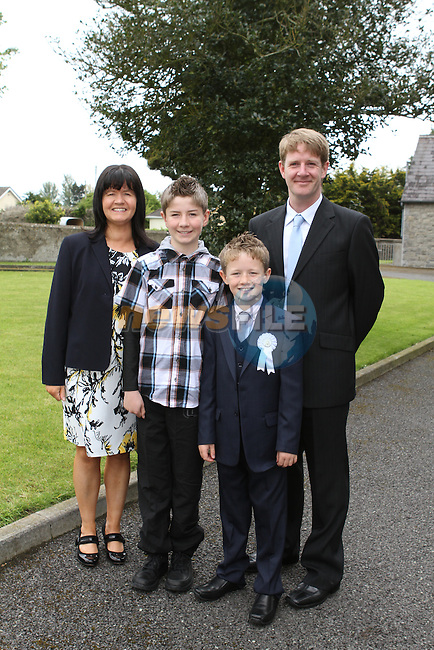 Robert Duff with his family at the Communion in Duleek Church...(Photo Jenny Matthews/www.newsfile.ie)