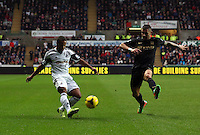 Wednesday, 01 January 2014<br /> Pictured: Wayne Routledge (L).<br /> Re: Barclay's Premier League, Swansea City FC v Manchester City at the Liberty Stadium, south Wales.