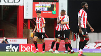 Ethan Pinnock hugs Henrik Dalsgaard at the final whistle as Brentford celebrate another victory during Brentford vs Preston North End, Sky Bet EFL Championship Football at Griffin Park on 15th July 2020