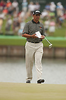 PONTE VEDRA BEACH, FL - MAY 6: Tom Pernice, Jr. makes his personal notes on the 17th green during his practice round on Wednesday, May 6, 2009 for the Players Championship, beginning on Thursday, at TPC Sawgrass in Ponte Vedra Beach, Florida.