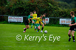 Oisin Fleming of Kerry slips past Eamon Meehan and Darragh Jayes of Limerick County in the 2021 Kennedy Cup