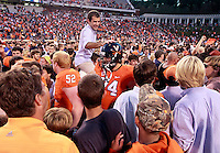 Oct. 15, 2011-Charlottesville, VA.-USA- Virginia Cavaliers fans storm the field celebrating with players the 24-21 win over Georgia Tech at Scott Stadium.  (Credit Image: © Andrew Shurtleff